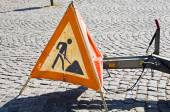 Red warning triangle with works ahead sign — Stock Photo