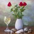 Red roses in vase, white wine glass and shells — Stock Photo #57470201