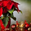 Winter rose, candle and Christmas decorations — Stock Photo #57471049