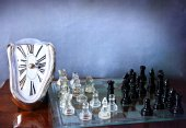 Chessboard game and Dali-like clock — Stock Photo