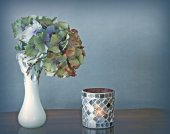 Hydrangea flower in vase and candle — Stock Photo