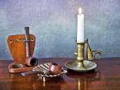 Old pipes and candle — Stock Photo