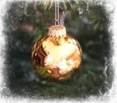 Golden Christmas tree ball framed in white — Stock Photo