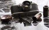 Old camera in backlight — Stock Photo