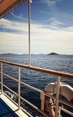 Seascape with island from a cruise vessel — Stock Photo