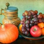 Still life: seasonal fruits and hokkaido pumpkin and a mug — Stock Photo #58760463