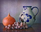 Water jug, pumpkin and grapes — Stock Photo