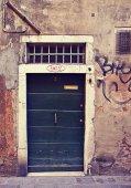 Antique Venetian door with grate — Stock Photo