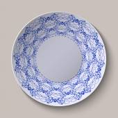 Round blue floral ornament ethnic style. Pattern shown on the ceramic plate. — Stock vektor