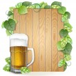 Beer and hops on a wooden background — Stock Vector #55146145