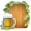 Beer mug and hops on a wooden background — Stock Vector #55147311