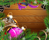 Baubles and fir branches on wooden board — Stockvektor