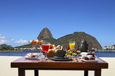 Breakfast  with mountains on background — Stock Photo