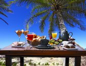 Breakfast  with beach on background — Photo