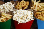 Popcorn, roasted potatoes and crackers — Stock Photo