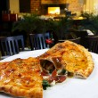 Calzone pizza on plate — Stock Photo #69308347