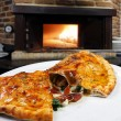 Calzone pizza on plate — Stock Photo #69308413