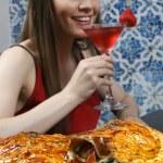 Girl eating Pizza calzone — Stock Photo #69894523