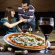 Couple drinking wine and eating pizza — Stock Photo #69894597