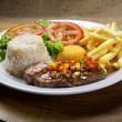 Steak with rice and vegetables — Stock Photo #69900365