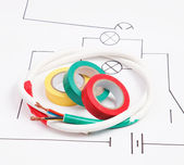 Adhesive plastic tape and electric cable on a background of the electric scheme — Stock Photo