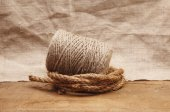 Hank of rope on the background of burlap — Stock Photo