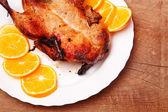 Roast duck with oranges — Stock Photo