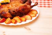 Roast duck with apples and oranges — Stock Photo
