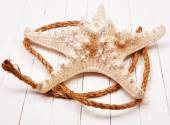 Starfish on a white background wooden table — Photo