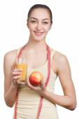 Beautiful girl with juice and apple — Stock Photo