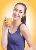 Beautiful girl holding a glass of juice. Female model hold orange juice glass — Stock Photo