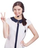 Young beautiful girl in headphones with a microphone shows something with her fingers — Stock Photo