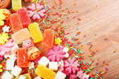 Sweets and candies on a wooden table — Stock Photo