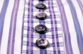 Buttons on a striped purple shir — Stock Photo