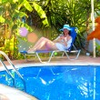 Relaxing in the garden by the pool — Stock Photo #58885645