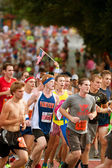 Runner Holds Small American Flag In Atlanta Road Race — Stok fotoğraf