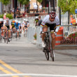 Постер, плакат: Cyclist Separates Himself From Pack In Criterium Event