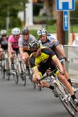 Pack Of Cyclists Lean Into Turn In Criterium Event — Stock Photo