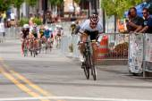 Cyclist Separates Himself From Pack In Criterium Event — Stock Photo