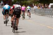 Cyclists Sprint Down Street In Duluth Criterium Event — Stock Photo