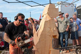 Chainsaw Sculptor Creates Wooden Dog Sculpture — Stock Photo