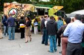 Customers Stand In Long Line To Order From Food Trucks — Stock Photo