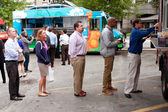 Customers Stand In Line To Order Meals From Food Trucks — Stock Photo
