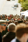 Flying Drone Hovers Over Crowd At Fair — Stock Photo