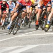Male Cyclists Lean Into Turn In Amateur Bike Race — Stock Photo #76930705