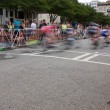 Motion Blur Of Cyclists Speeding Through Turn In Amateur Race — Stock Photo #76930867