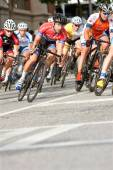 Male Cyclists Lean Into Turn In Amateur Bike Race — Stock Photo