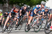 Tight Pack Of Cyclists Lean Into Turn In Amateur Race — Stock Photo