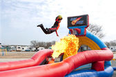 Man Jumps Over Fireball To Dunk Ball In Carnival Act — Stock Photo