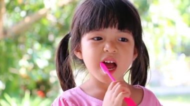 Cute Asian Girl Brushing Teeth (No Toothpaste) — Stock Video